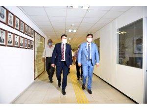 DP Genel Başkanı Gültekin Uysal, Alim Karaca'yı ziyaret etti